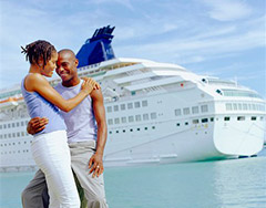 couple in love with cruise ship in background