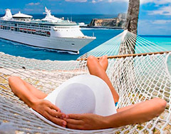 relaxing in hammock with cruise ship in distance